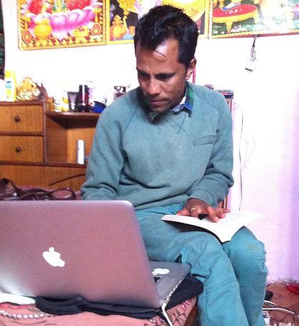 Nepalese an using a Mac