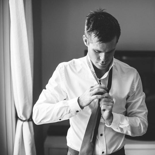 Groom fixing his tie - Galway wedding photographer