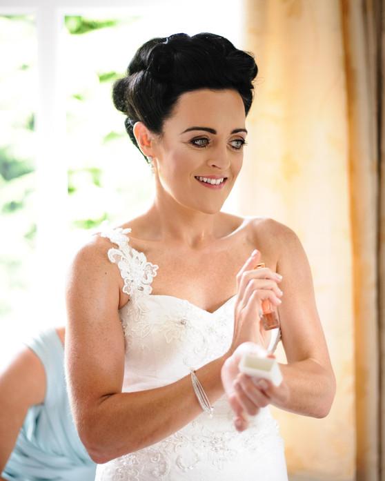 bide putting on purfume - Galway wedding photograper