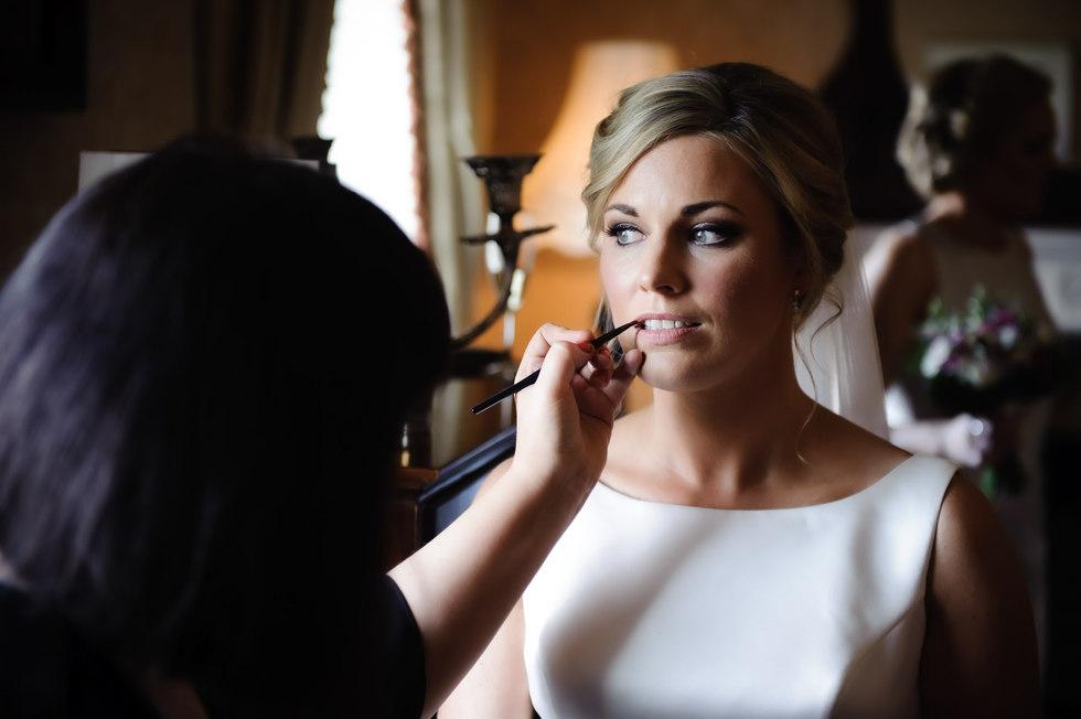 beautiful bride getting her makeup applied - Galway wedding photographer