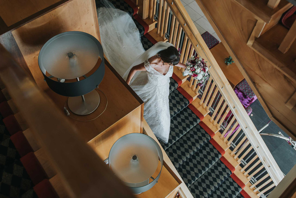 Bride walking down the stairs to the wedding ceremony - Galway wedding photographer