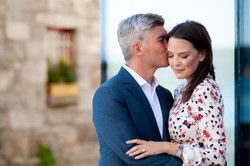 engagement man kissing a woman on the cheek - Galway wedding photographer
