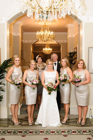 beautiful bridal party posing at a luxury hotel - Galway wedding photographer