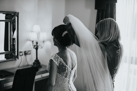 Bride getting her veil attached - Galway wedding photographer