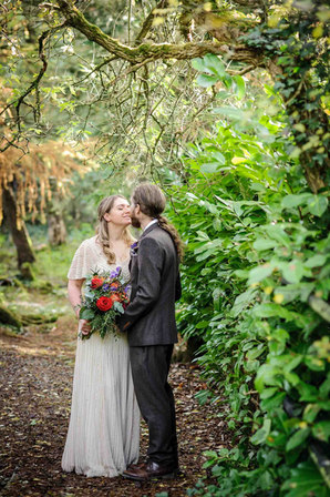 bride and groom kissing in the woods - Galway wedding photographer