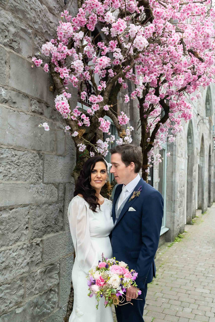 Beautiful bride with pink flowers - Galway wedding photographer