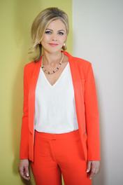 Siún Nic Gearailt wearing an orange suit - Declan Colohan Photography Galway