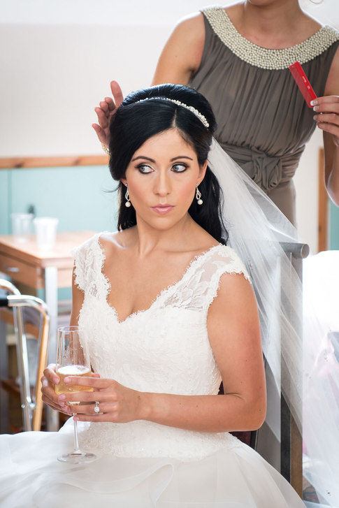 finishing touches to bridal hair - Galway wedding photographer