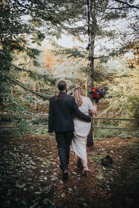 Trendy bride and groom walking in the woods - Galway wedding photographer