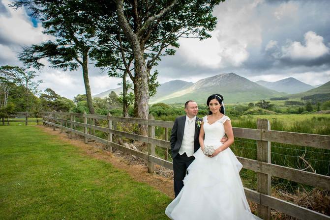 Bride and groom at Kylemore abbey in connemara Galway wedding photograper