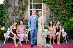 bridal party posing at a castle in Ireland - Galway wedding photographer