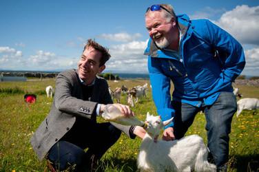 Ryan Tubridy feeding a goat on the aran islands - Galway PR photographer