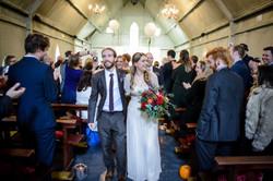 Bride and groom walking down the isle - Galway wedding photographer