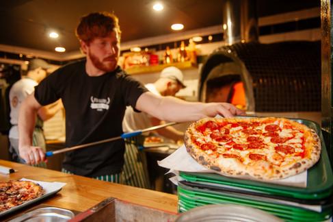 Dough Bros servin a pizza - - Galway PR Photographer