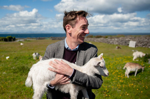 Ryan Tubridy holding a goat - Galway PR photographer