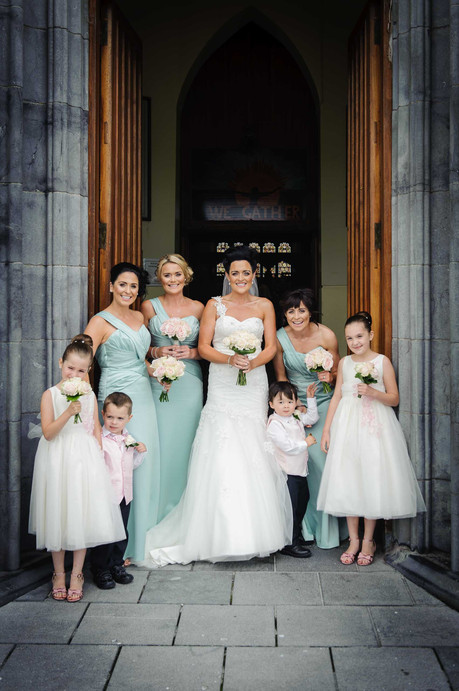 bride and bridal party at the entrance to the wedding church - Galway wedding photograper