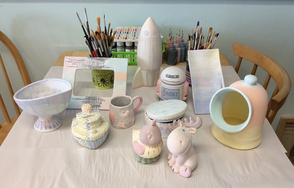 painted pottery ready for glazing and firing
