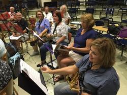 5 Saxophones at Rehearsal