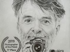 Grafit karikatúra - Photographer of the Planet