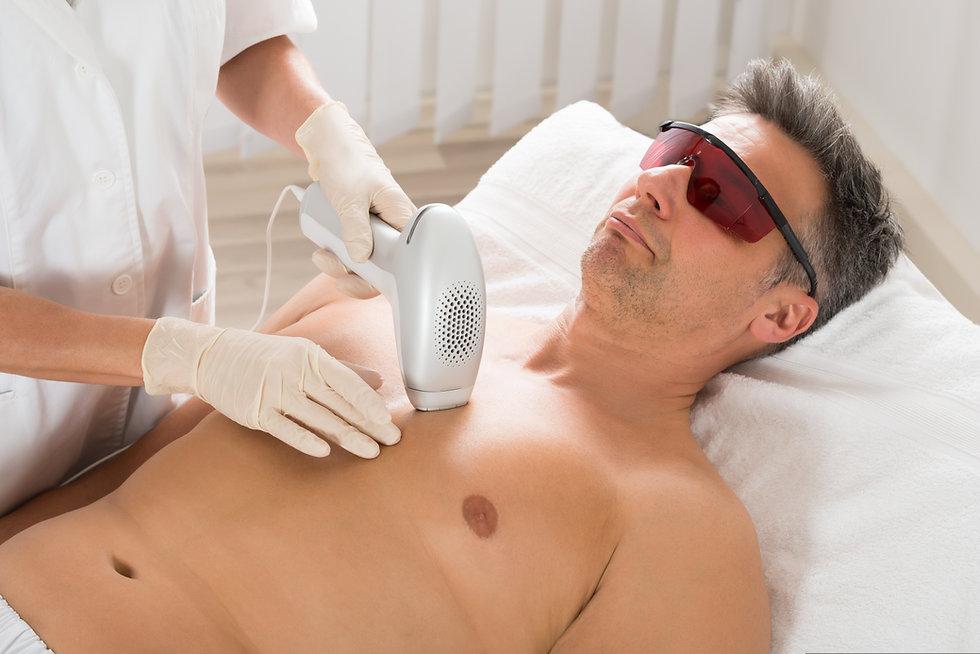 Beautician Giving Laser Epilation Treatm