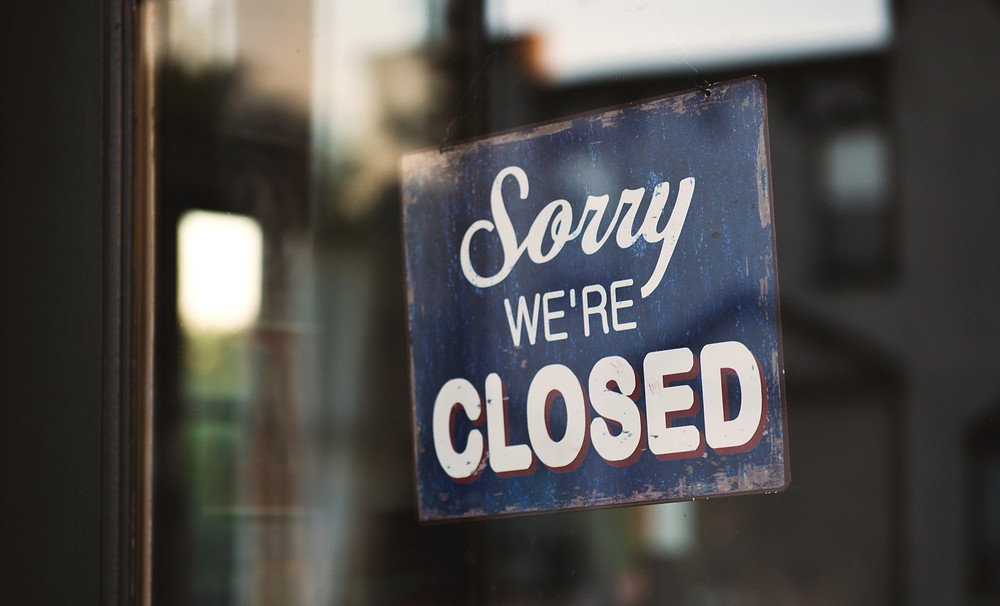 Closed sign in salon business window