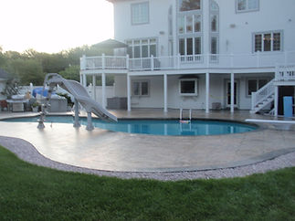 stamped concrete pool deck with a stained border