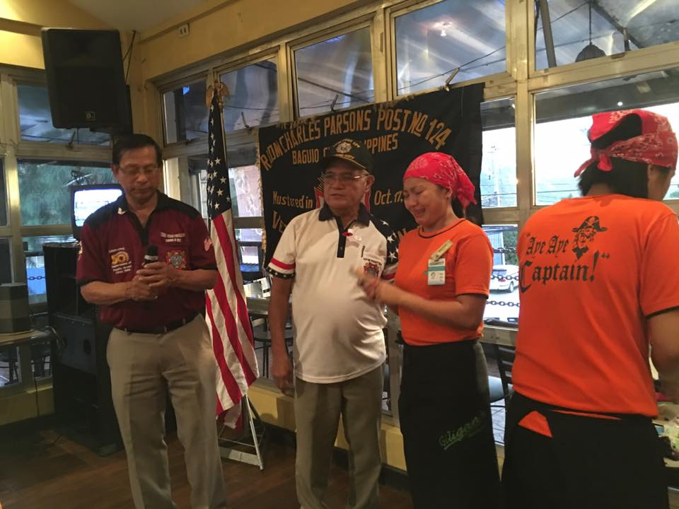 Cdr JoeA and QM JoeCat presenting money to waitress of Gilligans