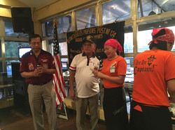 Cdr JoeA and QM JoeCat presenting money to waitress of Gilligans