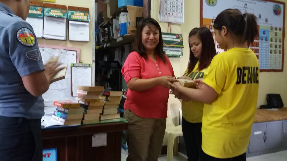 Comrade Jenny Johnson giving away books and magazines to Baguio Womens Jail