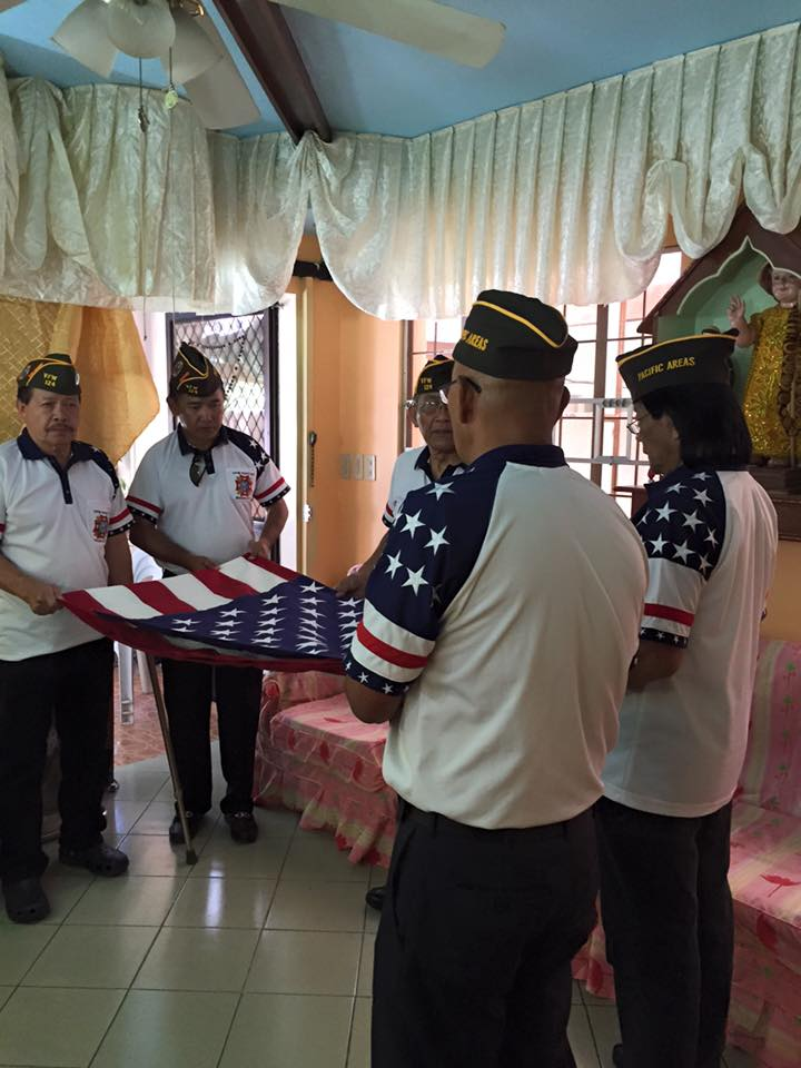 VFW Members placing flag to Comrade Ortiguero's casket