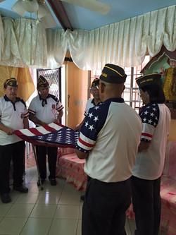 VFW Members placing flag to Comrade Ortiguero's casket