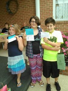 3 kids holding paper.jpg