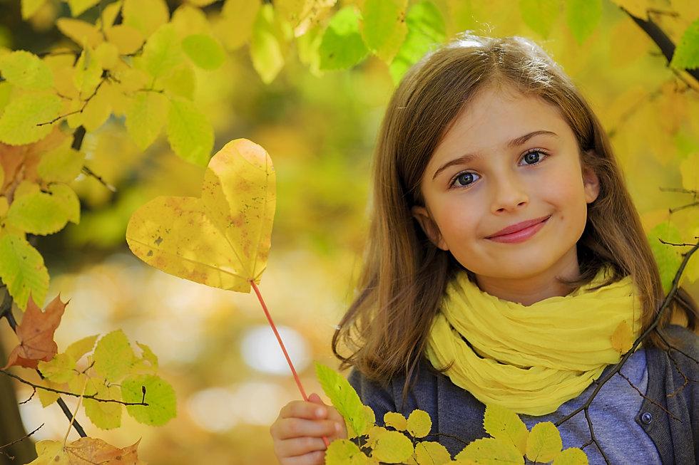 Autumn fun - lovely girl has a fun in au