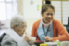Filipino certified caregiver feeding the patient in NY, NJ, CT USA