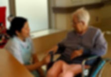 Filipino certified caregiver talking to patient in NY, NJ, CT USA