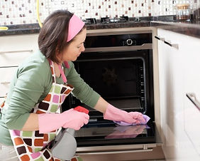 filipina housekeeper cleaning the kitchen