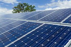 Solar-Panels-on-Factory-Roof-nice-sky-ba