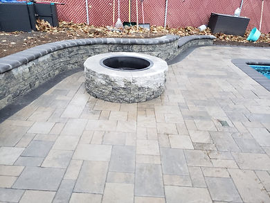FIREPIT AROUND A POOL PATIO