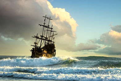 Pirate ship at the open sea at the sunset.jpg