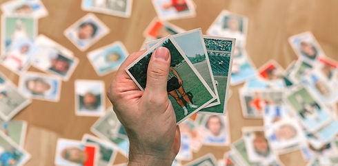 Male Holding Trading Cards
