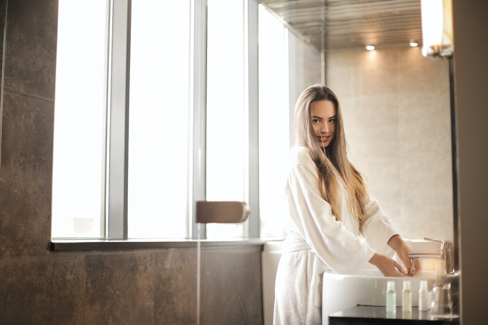 photo-of-woman-in-white-bathrobe-standin