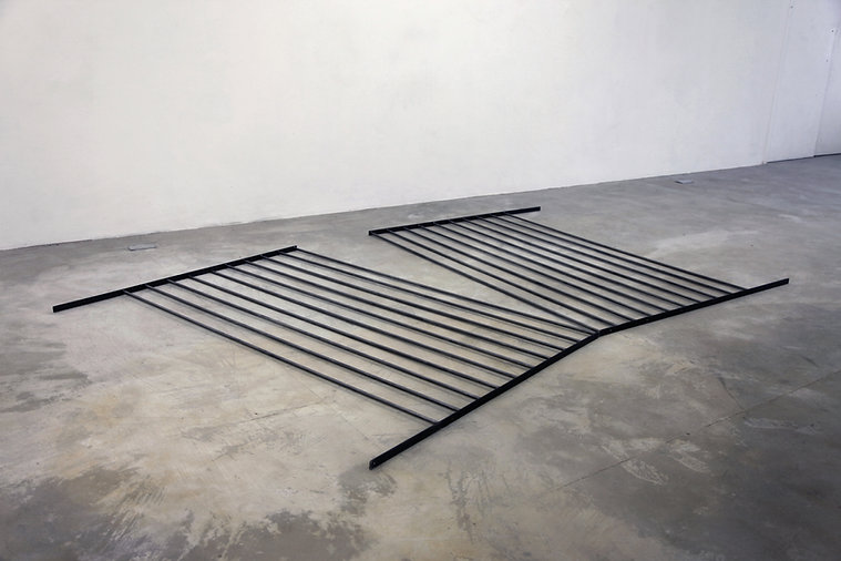 Simona Brinkmann, Training Camp - steel and graphite, metal sculpture, floor sculpture, collapsed gate doors, post-minimalism, contemporary art, infrastructures of control, crushed barrier, metal bars