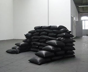 Simona Brinkmann, Fort Worth #4 - Leather, sand. The Aesthetics of Anxiety, Leather Sandbag floor sculpture, installation, contemporary art, modular sculpture, post-minimalism, defensive structures, luxury fortification, disaster art.