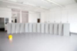 Simona Brinkmann,  Ungrammatical Anatomies II, grey Marmox insulation board, cement, fibreglass, steel, graphite. Barrier sculpture, installation, curve obstruction, crowd barrier, post-minimalism, contemporary art.