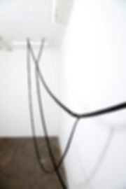 Simona Brinkmann, Arm's Length - black leather strap sculpture installation, avant bridle harness, metal fittings, press studs, hanging sculpture, horse tack, post-minimalism, contemporary art. Blank Stare Flat Hollow solo show at Five Years, London.