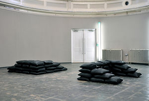 Simona Brinkmann, Fort Worth #6 - Leather, sand. Zabludowicz Collection, Testing Ground, Contested Ground, Leather Sandbag floor sculpture, installation, contemporary art, modular sculpture, post-minimalism, defensive structures, luxury fortification, disaster art.