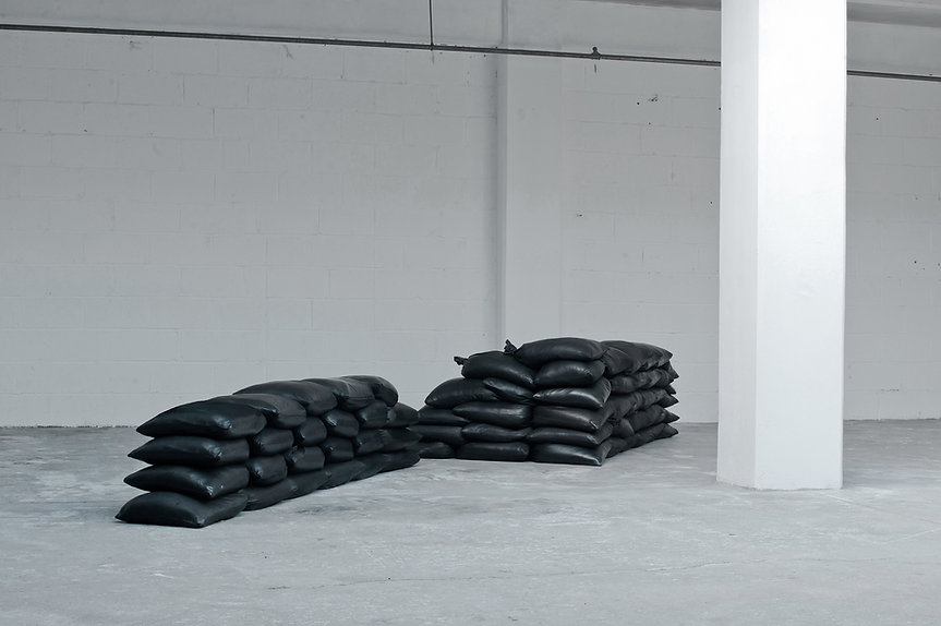 Simona Brinkmann, Fort Worth #7 - leather sand, black leather covered sandbag installation, cumulative modular sculpture, defensive architecture, luxury fortification, disaster art, contemporary art, post-minimalism, Vessel at KARST Projects Plymouth.