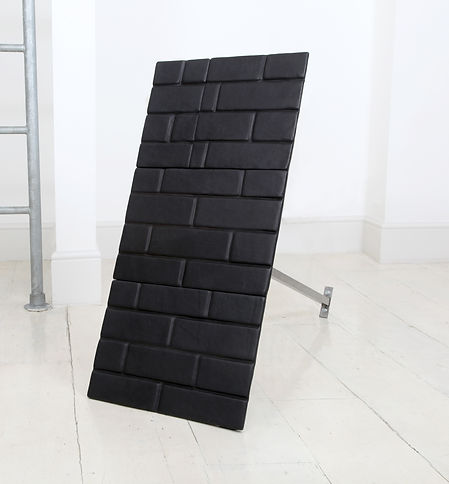 Simona Brinkmann, Check Point - foam padded leather, steel, magnets, floor sculpture, contemporary art, post-minimalism, relief, brick pattern, modular sculptured, wall fragment, luxury obstruction, padded cell wall fragment, automotive interiors. Secret European Studio group show.