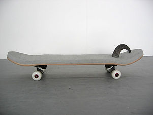 Simona Brinkmann, Bullseye, modified skateboard sculpture, skateboard, plaster cement mix, animal horn, wheels. Floor sculpture, sculptural object, art editions, contemporary art.