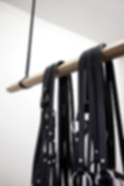 Simona Brinkmann, Rig - detail - leather, metal fittings, oak, metal chain. Hanging black leather strap sculpture, avant bridle, harness, horse tack, contemporary art, post-minimalism. Hold On! Solo show at The Agency, London.